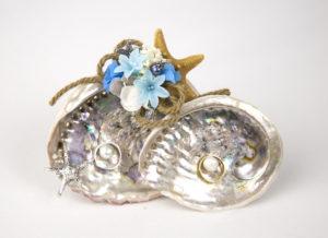 porta anillos de caracola con perlas